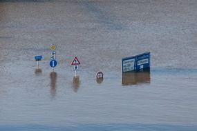 roadsigns underwater climate danger disaster environment