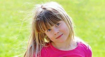 cute blond girl with forelock