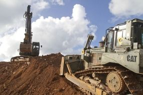 An excavator and a bulldozer at work