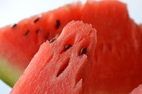 slices of watermelon with seeds