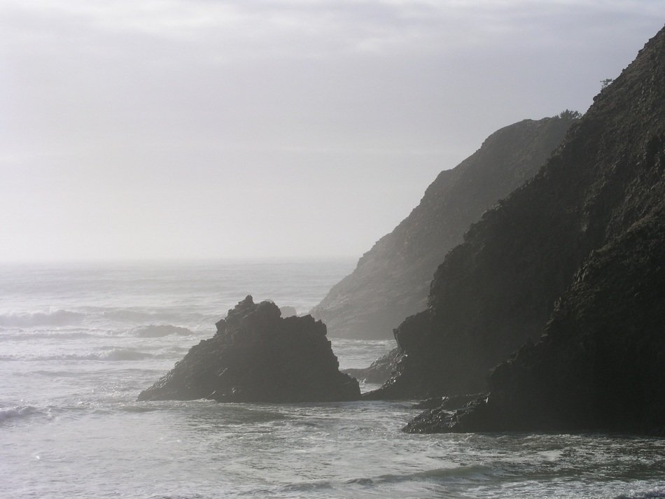 panoramic view of rocky pacific coast in oregon in bright sunshine