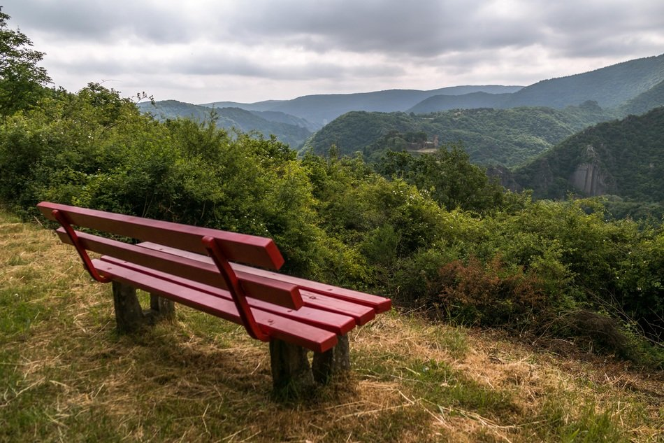 red bench with a view of the mountains