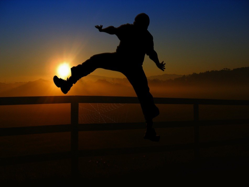 jumping man against the sunset