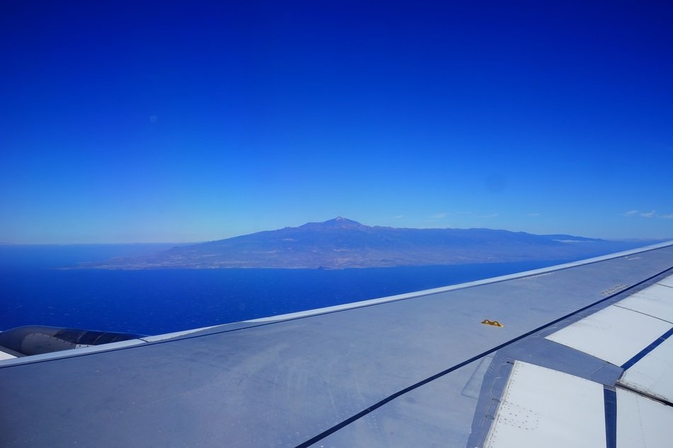 aircraft wing in view of scenic island in sea, spain, canary islands, tenerife