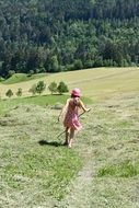 girl in pink hat meadow