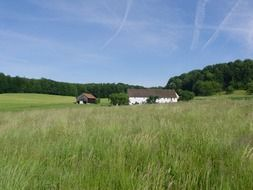 barn in a green field in picturesque Germany