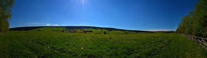 green field blue sky panorama