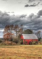 red barn in the autumn field
