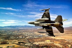 military fighter flies over Las Vegas