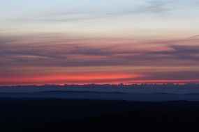 distant view of alpine mountains at sunset