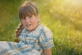 child girl blond portrait in the meadow
