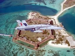 fighter flies over Fort Jefferson