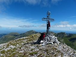 summit cross on cima della saline mountain at sky, italy