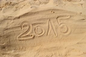 """2015"" in the sand on the beach"