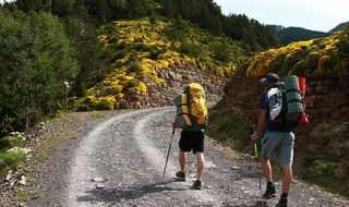 people with backpacks walking on mountain trail, spain, ordesa national park