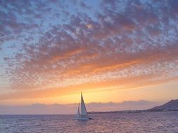 yacht in the sea colorful sunset