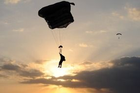 skydiver at sunset