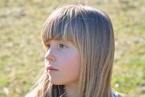 photo of a pensive girl with blond hair