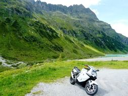 parked motorcycle on the background of the Silvretta mountain range