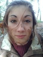 young girl with mud on her face