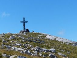 metal cross on the mountain summit