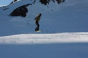 a lonely snowboarder on the freeride