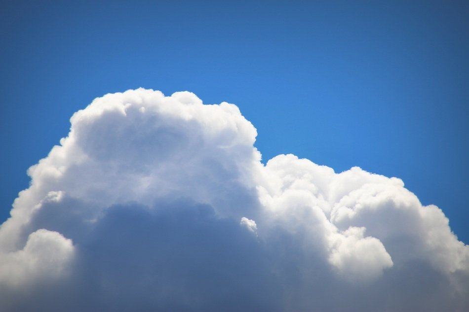 cumulus clouds on the summer blue sky