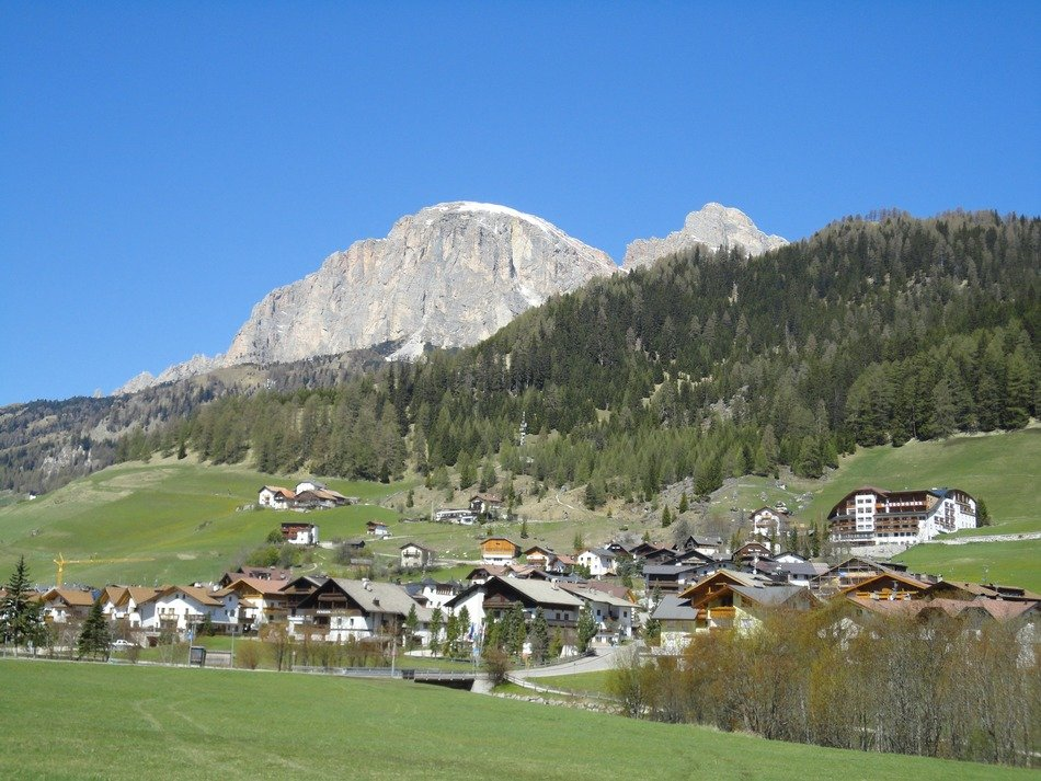 village at the foot of dolomites mountains