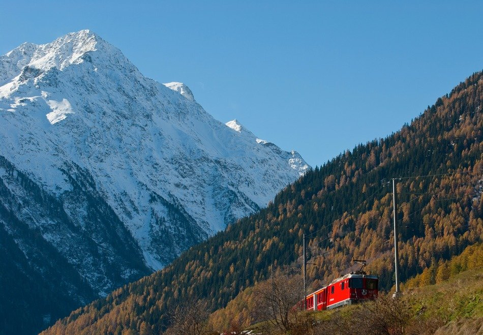 red train against the background of the picturesque landscape of Switzerland