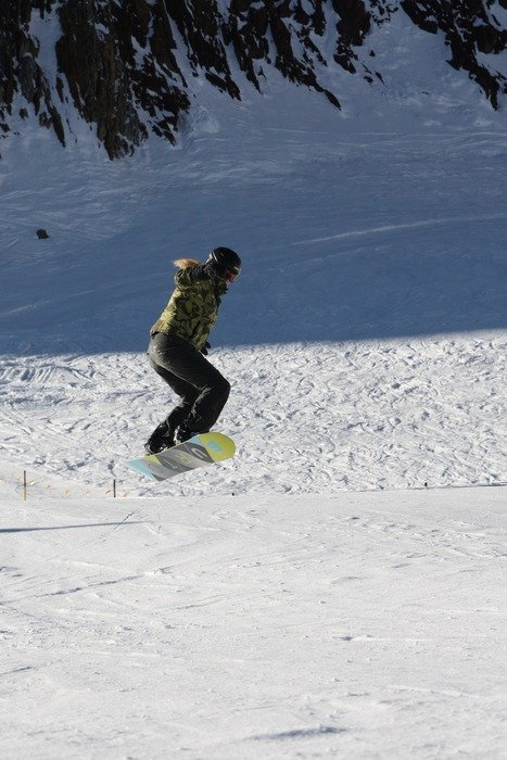 snowboarder jump on a snowy slope