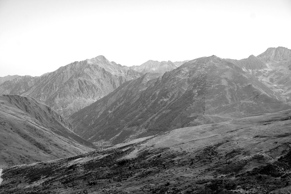black-and-white image of the countryside in the Alps