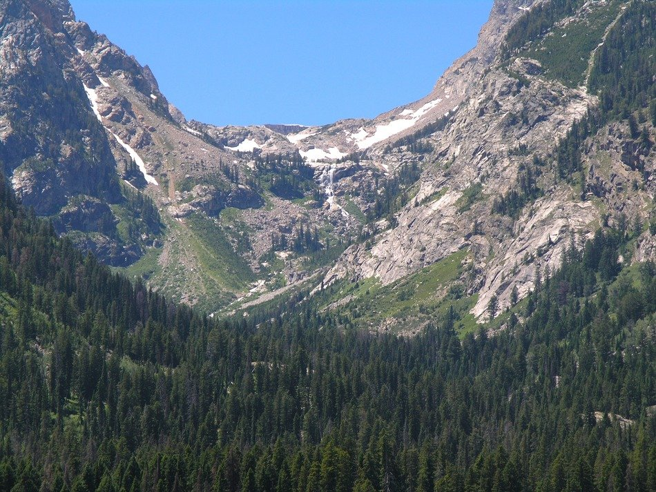 ravine on a background of snow-capped mountains in Grand Teton National Park