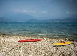 beach kayaks lake garda italy