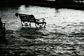 bench in the water during a flood