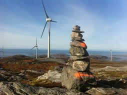 cairn against the background of a windmill