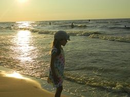 child on a beautiful beach in the evening