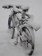 the bike is covered with snow