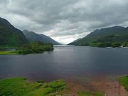 scenic mountain lake at cloudy evening, uk, scotland, loch shiel