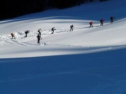 group of people in a ski tour