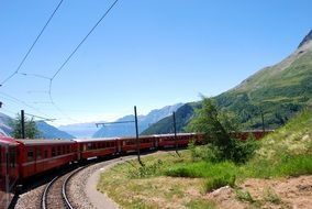 red train in the mountains in Switzerland
