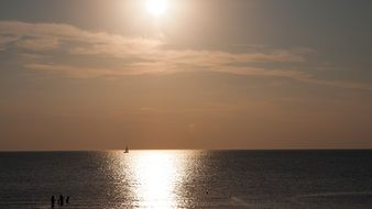 sailboat in the sea at sunset