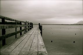 wooden pier on lake chiemsee in black and white tone