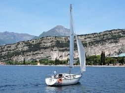 sailing boat on the lake in Italy