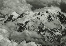 Alps in the clouds in black and white image