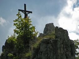wooden cross on top of a mountain