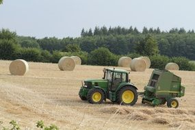 machine baling on the field