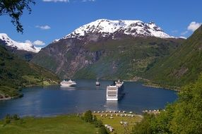 cruise ship among the fjords in Norway