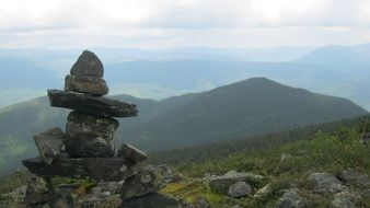 Landscape of inukshuk statue on a mountain