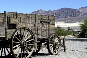 Wooden antique wagon in the desert