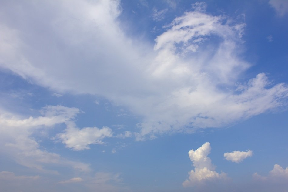 Beautiful blue gradient sky with white clouds